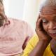 Senior man comforting senior woman